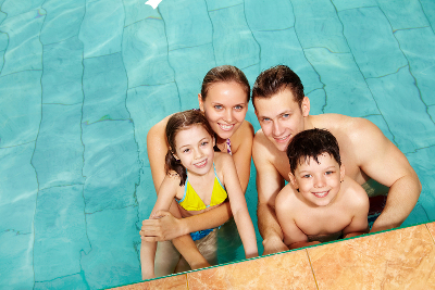 happy family in swimming pool houston tx